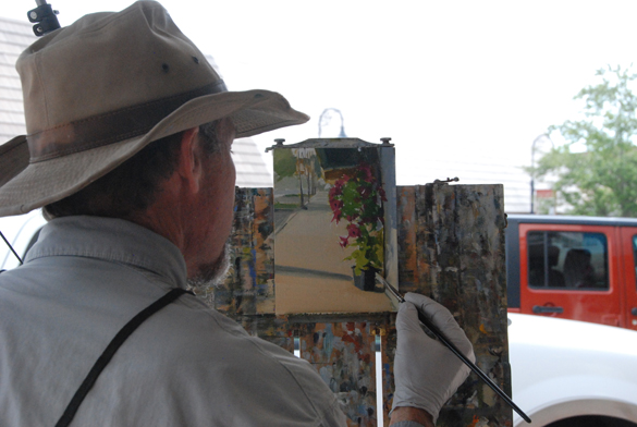 Artist Greg LaRock and his demo along the streets of Port St. Joe.